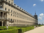 El Escorial Palace in Madrid - so big it's cloudy on one end, sunny on the other