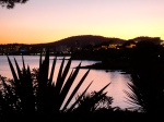 Sunset in Mallorca looking over the bay to the lights of Magaluf from the far calmer perspective of the Punta Negra