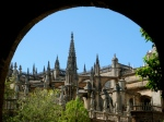 Catedral seen through an arch of the nearby Alcazar
