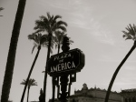Slender palms and modernist signage in the Parque Maria Luisa