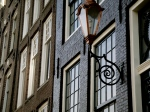 Beautiful lamps on Amsterdam buildings