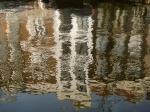 Amsterdam - the city which doubles itself with canal reflections