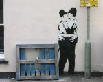 Banksy - Kissing Coppers (originally sprayed onto the side of a pub in Brighton)
