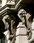 These stunning elephants are on the side of a magnificent bank building