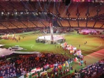 The national flags enter the stadium