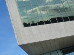 The Albert Docks reflected in the window of Danish-designed Museum of Liverpool