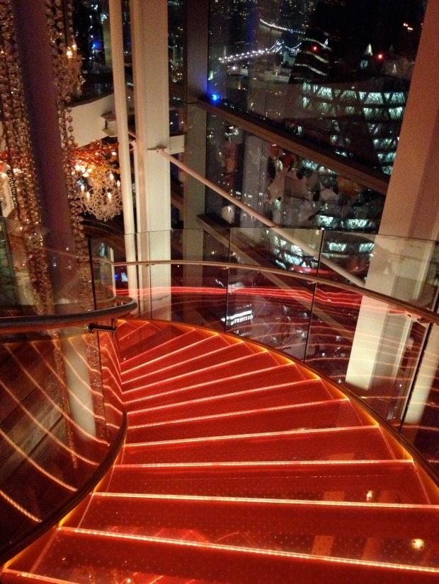 The staircase in the bar - check out the gherkin outside