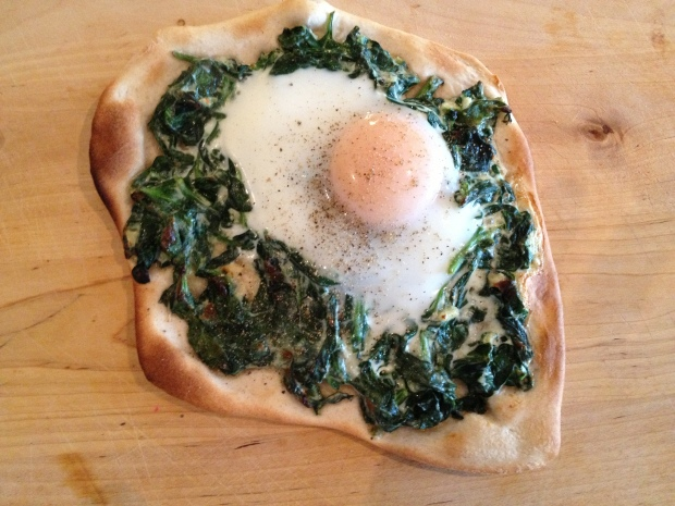 Spinach with a soft-cooked egg