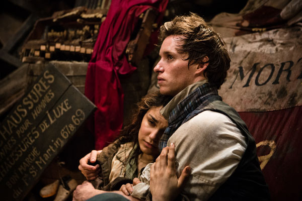 Eddie Redmayne and Samantha Barks as Marius and Éponine