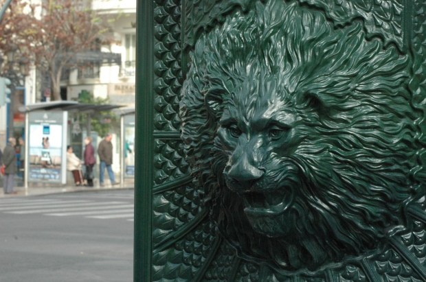 Lion detailing on an advertising post