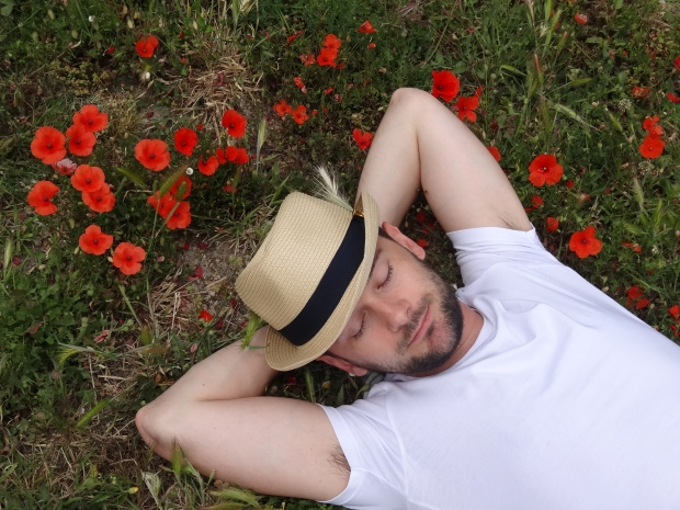 Dominik takes a rest amongst the poppies, Oz style.