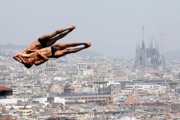 Mexico's Garcia and Sanchez perform dive during practice for men's synchronised 10m platform event in Barcelona